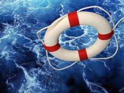 Life saver falling on blue churning water