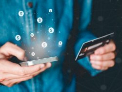 Online banking businessman using smartphone with credit card Fintech and Blockchain concept